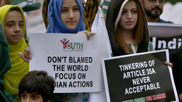 Members of the Youth Forum for Kashmir, a civil society group, protest against India's policy in Islamabad, Pakistan.