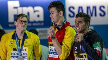 Mack Horton (left) made his point against Sun Yang (centre).