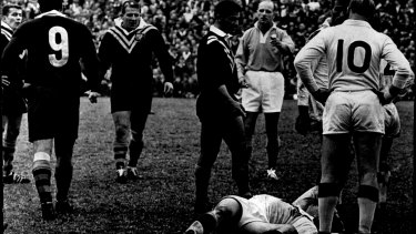 England second-rower Bill Ramsay lies unconscious after an altercation with Kelly (No.9) during a Test match in 1966.