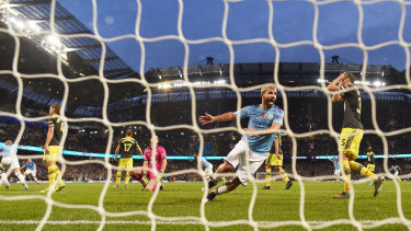 Aguero watches the ball go in from Kyle Walker.