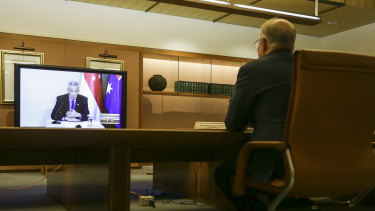 Prime Minister Scott Morrison meets with his Singaporean counterpart Lee Hsien Loong (on the screen) and his delegation during a virtual summit in March.
