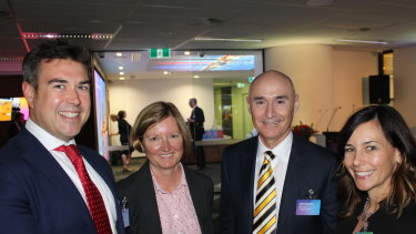 Brendon Riley (middle right) has been in charge of steadying the ship at Telstra Health.