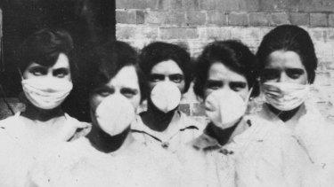 A group of volunteers prepare to go door-to-door to help people afflicted with Spanish Flu in Brisbane in 1919.