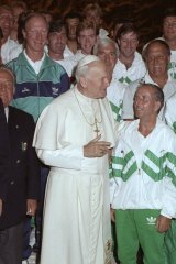 Pope John Paul II stands in front of Jack Charlton and  with the Ireland team during the World Cup in Italy.