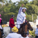 "Hugh Bowman hurls his goggles to ""the crowd after the Golden Slipper"