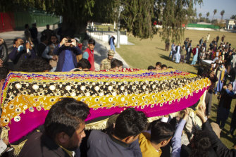 Relatives carry the body of journalist Malala Maiwand at her funeral.