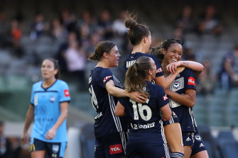 Melbourne Victory celebrate a goal against Sydney FC in round 14.