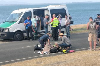 Shannon Malseed receives roadside medical attention following a crash at the end of stage two of the Bay Crits.