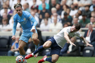 Jack Grealish, on his Premier League debut for Manchester City, is challenged by Tottenham's Pierre-Emile Hojbjerg.