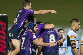 Melbourne Storm celebrate after Tui Kamikamica's try.