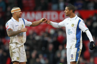 Patrick Kisnorbo (left) during his days as a rugged centre-back for Leeds.
