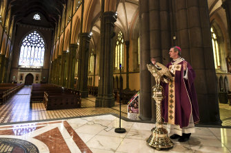 Archbishop Comensoli delivers the homily to empty pews as a result of COVID-19 restrictions earlier this year.