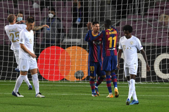 Lionel Messi and Ousmane Dembele celebrate the latter's goal in the 5-1 rout of Ferencvaros.