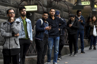 International students queuing outside Melbourne Town Hall for food vouchers in May.