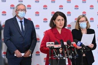 Bleak: NSW Health Minister Brad Hazzard, Premier Gladys Berejiklian and Chief Health Officer Kerry Chant on Friday.