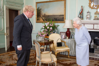 The Queen greets Prime Minister Boris Johnson in June at their first in-person weekly meeting since the start of the coronavirus pandemic.