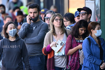 People queue outside Centrelink in Melbourne in March.