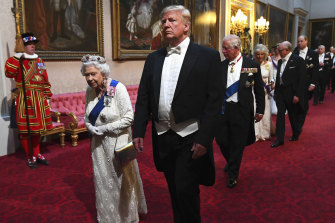 The Queen and president Donald Trump arrive with others at Buckingham Palace ahead of a state banquet in 2019.