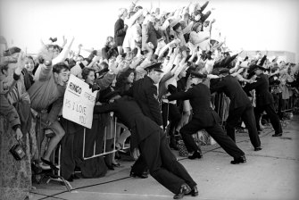 Crowd control: fans await the arrival of Ringo Starr in 1964 at Sydney Airport.