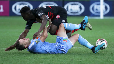 Mohamed Adam of Western Sydney Wanderers crash's into Scott Jamieson of Melbourne City.