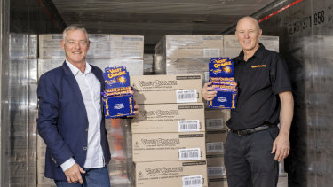 Richard Sims (left) and Phil Sims with the first shipment of 77,000 Violet Crumbles.