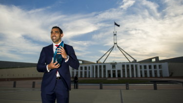 Off-field impact: Adam Goodes accepting his Australian of the Year award in 2014.