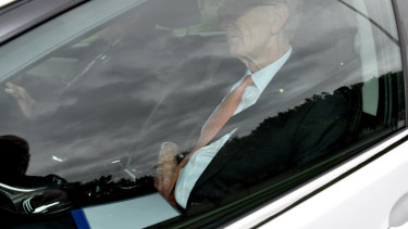 Commissioner Kenneth Hayne arrives at government house with the final report of the royal commission.