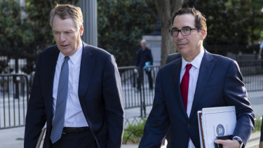 The US representative, Robert Lighthizer, left, and Treasury Secretary Steven Mnuchin return to the White House after the talks.