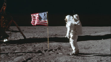 In this July 20, 1969 photo made available by NASA, astronaut Buzz Aldrin Jr. poses for a photograph beside the US flag on the moon during the Apollo 11 mission.