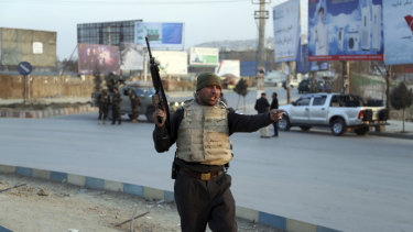 Afghan security forces arrive at the site of an explosion and attack by gunmen, in Kabul.