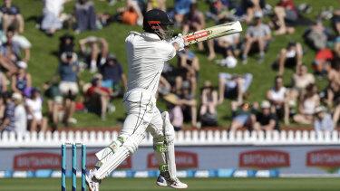 Aggressive: Kane Williamson strikes a boundary in Wellington.
