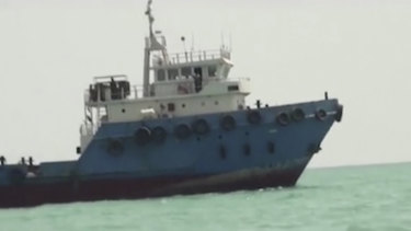 This image shows a ship in the Persian Gulf. Iranian forces seized the ship, which it suspected of carrying smuggled fuel, state media reported.