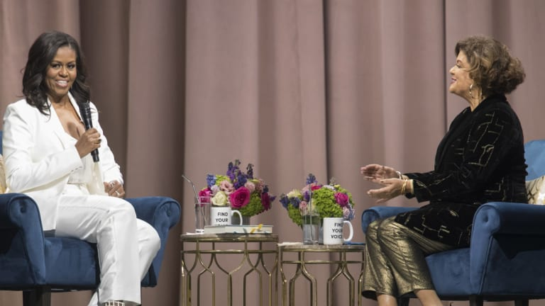Former first lady Michelle Obama, left, is interviewed by Elizabeth Alexander at Barclays Centre in Brooklyn.