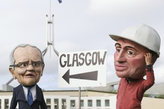 Protestors dressed as Prime Minister Scott Morrison and Deputy Prime Minister Barnaby Joyce on the lawns of Parliament House on Thursday.