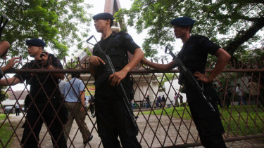 Indonesian police officers guard a church compound following an attack in Medan in 2016.