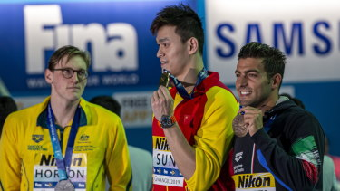 Mack Horton (left) made his point against Sun Yang (centre) but says the focus should shift to racing for the time being.