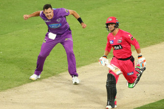 Scott Boland of the Hurricanes takes the wicket of Josh Philippe of the Sydney Sixers.