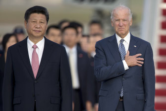 Chinese President Xi Jinping, then Vice-President Joe Biden, stand for the U.S. national anthem during an arrival ceremony in Andrews Air Force Base in 2015.