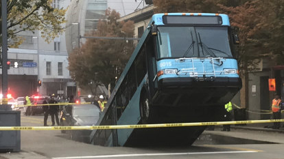 Sinkhole opens, swallows part of Pittsburgh bus during peak hour