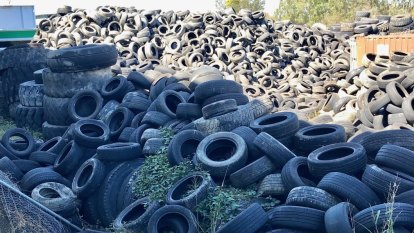 Mountain of old tyres a 'catastrophic fire risk' for Brisbane's south