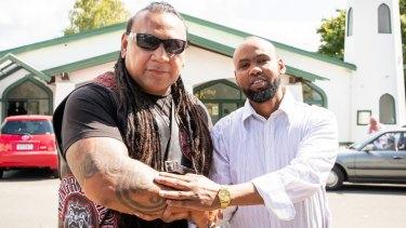Mongrel Mob Waikato president Sonny Fatu with Hanad Ibrahim from Jamia Mosque in Hamilton.