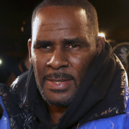 R. Kelly turns himself in at a Chicago police station after being charged with sexual abuse.