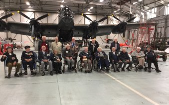 Veterans who flew to England last year with a Lancaster at the Battle of Britain Memorial Flight, RAF Scampton. Bob Wade is seated third from left.