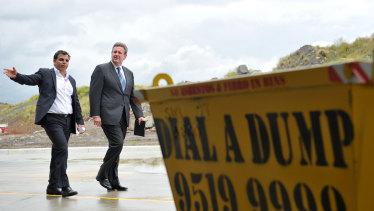 NSW Premier Barry O'Farrell and CEO of Dial A Dump Industries Ian Malouf (left) touring the city's biggest landfill site in Sydney in 2011.