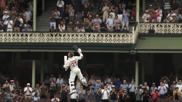 David Warner celebrates a century at the SCG against New Zealand last year.