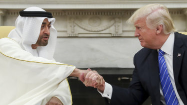 US President Donald Trump shakes hands with Abu Dhabi's crown prince, Sheikh Mohammed bin Zayed Al Nahyan, in the White House in Washington last year.