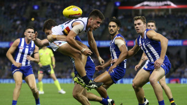 Crow Lachlan Murphy is tackled by Roo Scott Thompson at Marvel.