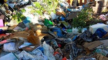 Contractors remove rubbish from the Bobolas home in Bondi in April 2014.