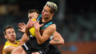 Powering on: Boyd Woodcock marks in front of teammate Charlie Dixon during Port Adelaide's win over Richmond.