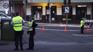 Police at the scene in Petersham where Bill Panagakos was shot dead in 2014.